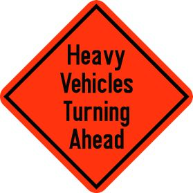 Construction heavy vechicles turning ahead sign