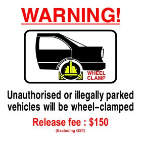 Wheel clamp area $150 release fee sign