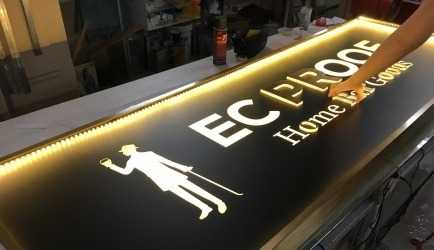 Bespoke brass lightbox with brass-faced 3D acrylic letters