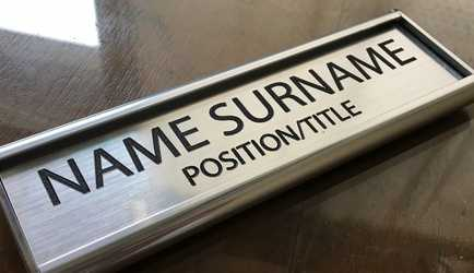 Framed silver office nameplate